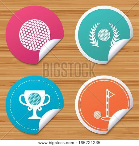 Round stickers or website banners. Golf ball icons. Laurel wreath winner award cup sign. Luxury sport symbol. Circle badges with bended corner. Vector