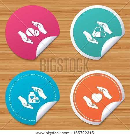 Round stickers or website banners. Hands insurance icons. Health medical insurance symbols. Pills drugs and tablets bottle signs. Circle badges with bended corner. Vector