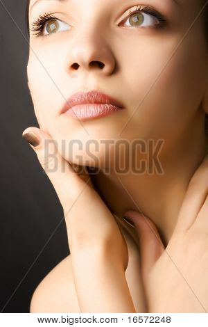 Close-up portrait of beautiful young fashion model
