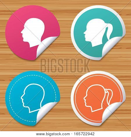 Round stickers or website banners. Head icons. Male and female human symbols. Woman with pigtail signs. Circle badges with bended corner. Vector