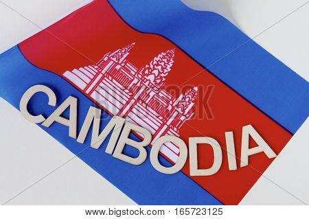 Cambodian signage on a fluttering Cambodian flag.