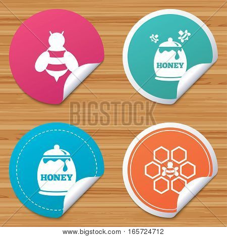 Round stickers or website banners. Honey icon. Honeycomb cells with bees symbol. Sweet natural food signs. Circle badges with bended corner. Vector