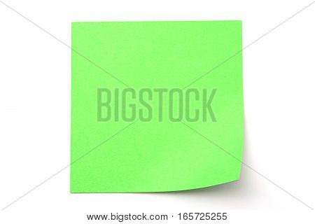 Green paper stick note on a white background
