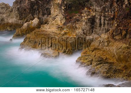 Misty water flowing over rocks in a long time exposure