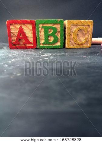 preschool ABC letter blocks on a blackboard