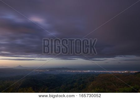 Aerial view of managua city at sunset time with colorful sky