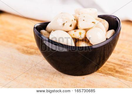Garlic Cloves On Wood