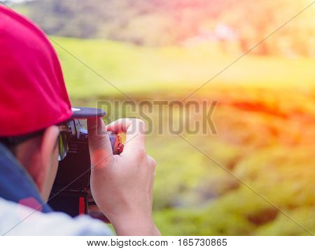 Landscape Photography, Photographer Ready to Take Landscape Pictures of tea farm at Cameron Highlands with Lens Flare or sunspot