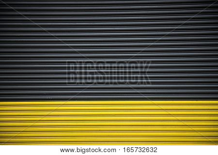 Background of color black and yellow garage entrance automatic door.