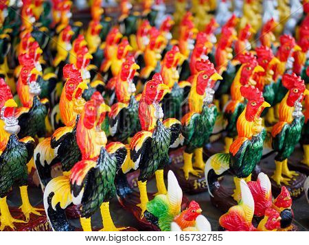 Colorful of a many cock statues, Roosters are placed around the temple dedicated to god of Thailand
