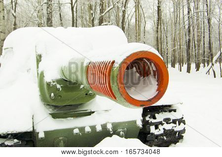 Military tank in the park under the snow winter in the park snow
