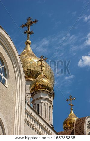 The gilt dome of an Orthodox church Dmitri Rostovsky in Rostov -on-Don Russia . The bright blue sky of May .