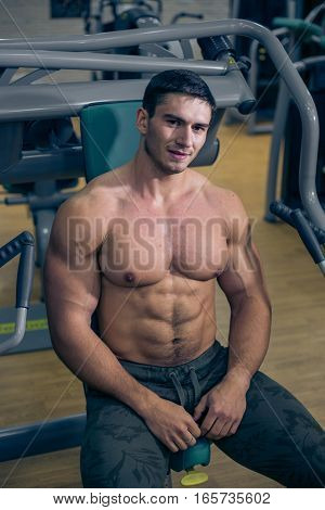 At the sports Hall. Man training. Sports. Hard Work Gym