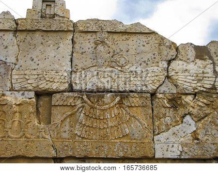 Faravahar zoroastrian symbol Naqsh-e Rustam Persepolis ruin Iran