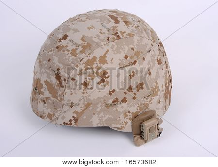 The modern USMC Marine Coprs Lightweight Combat Helmet LWH with Desert MARPAT Marine Pattern camouflage cover with IR lamp fitted to the side. poster