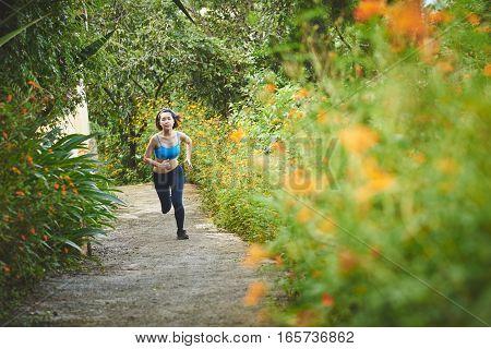 Asian pretty young woman jogging in garden
