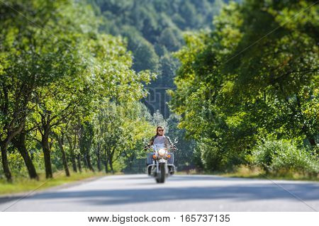 Biker Driving On The Road In The Forest