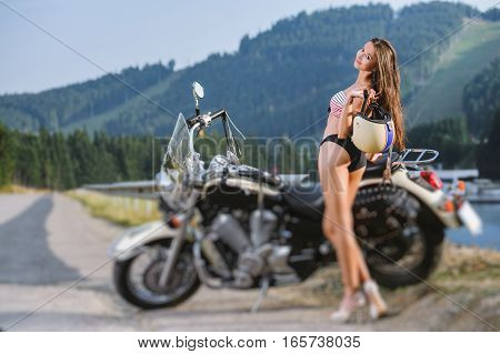 Sexy Girl Standing By The Custom Made Cruiser Motorcycle