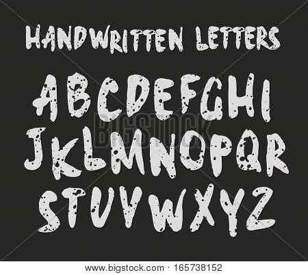 Vector handwritten brush script. Modern Brushed Lettering. Alphabet in grunge style. White print on black background