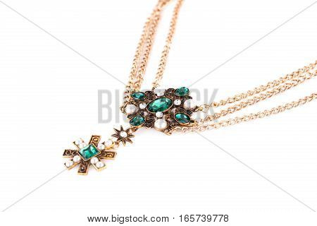 Stylish necklace with green stones and pearls isolated on white background.