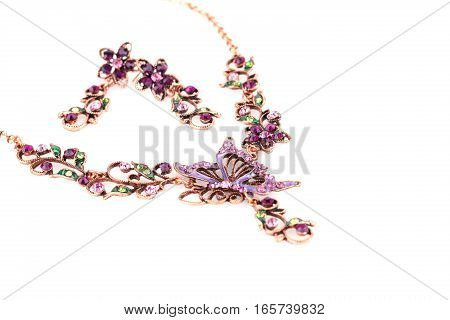 Stylish necklace and earrings isolated on white background.
