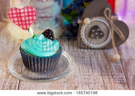 Vanilla cupcakes with decorative heart. There is a place for the text