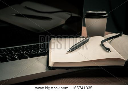Notebook Lying On The Laptop.