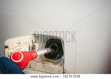 Refueling Nozzle Is Inserted In The Tank Car At A Gas Station