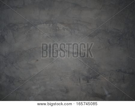 The dark cement wall texture and background