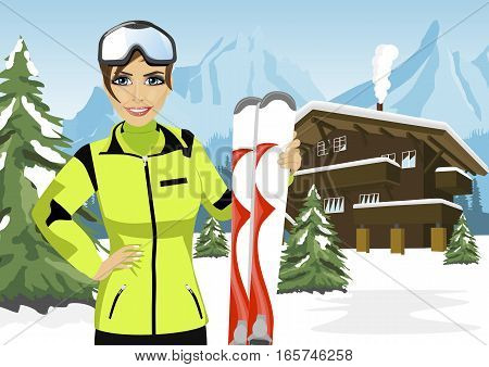 female mountain skier standing in front of a chalet in winter ski resort