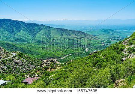 The skyline and foothill valleys from the Tahtakaracha pass Uzbekistan.