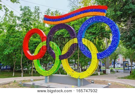 YEREVAN ARMENIA - MAY 29 2016: The installation depicts the Olympic rings and the flag of Armenia covered with bright flowers on May 29 in Yerevan.