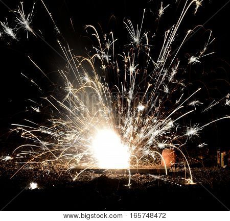 Small firework is sparkling in the dark