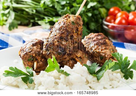 Barbecued Kofta With Rice On A Plate