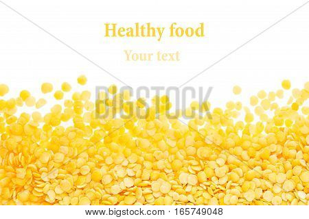 Border of yellow purified lentil closeup with copy space on white background. Isolated. Healthy protein food.