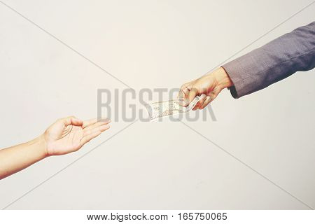 Businessman Hand Holding Us Dollar, Usd. Bills, Offers Dollar Bank Note Money And Giving Money Paid