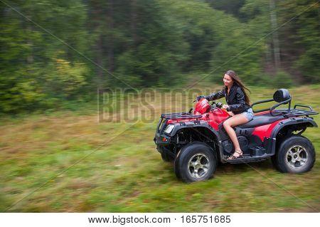 Beautiful Girl Driving Four-wheeler Atv