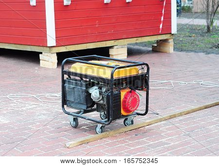 Mobile Diesel Generator on the Building Site Background