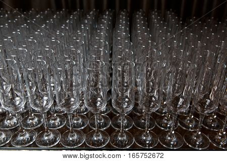 Photography of blank cleaning glasses against black background
