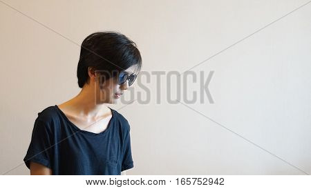 Short Hair Cool Asian Woman With Hipster Look, Wearing Casual Shirt And Sunglasses