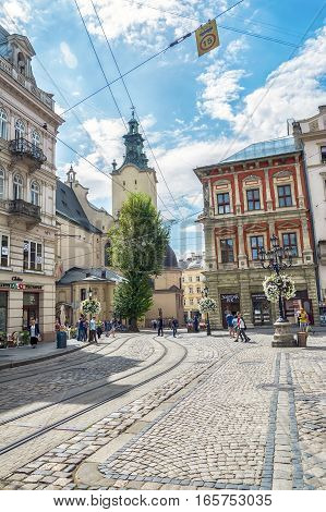 Lviv Ukraine - August 15 2016: Historic center of Lviv on the corner of Market Square near Latin Cathedral.