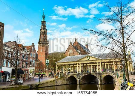 Leiden, Netherlands - April 7, 2016: Traditional houses, church and bridge in downtown of Leiden, Holland