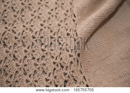 Brown Sweater Knitted In Manual Photographed In Close-up.
