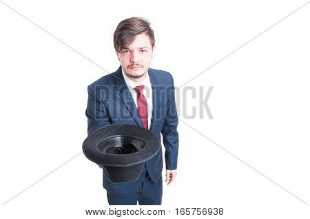 Young Man Wearing Suit Holding Hat Like Begging