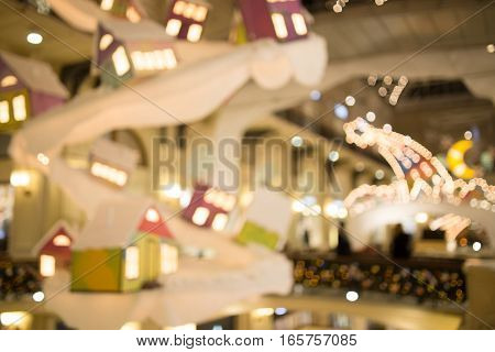 Defocused photo of festively decorated city at night