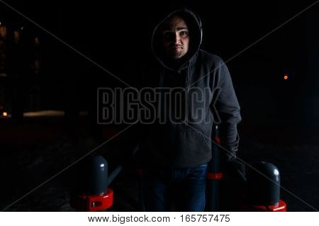 Photo of young man in headphones workout on street