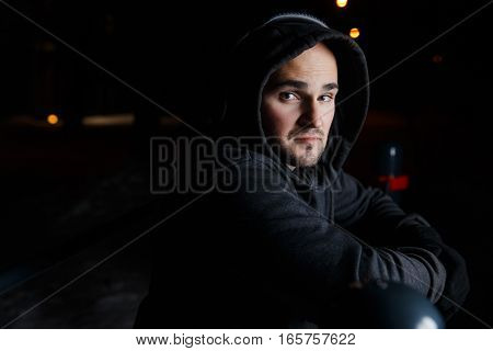 Photography of young man in headphones on street at night