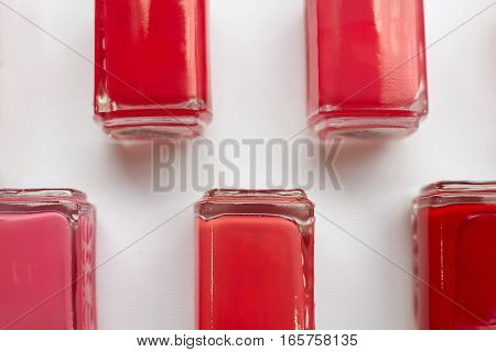 Red polish bottles over white a background.