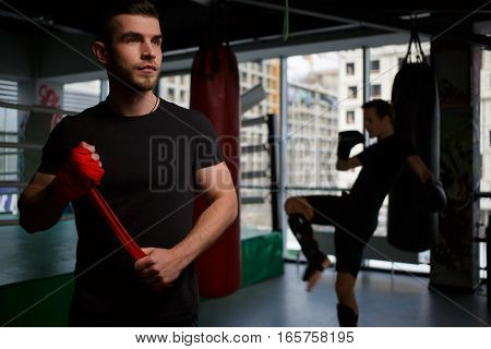 Portrait of young man boxing at gym