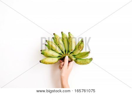 Hand holding bunch of bananas isolated. Flat lay top view. Creative food concept